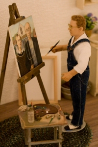 "A miniature scene depictiong Grant Wood as he paints ""American Gothic"""